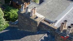 Image shows chimneys on a slate roof